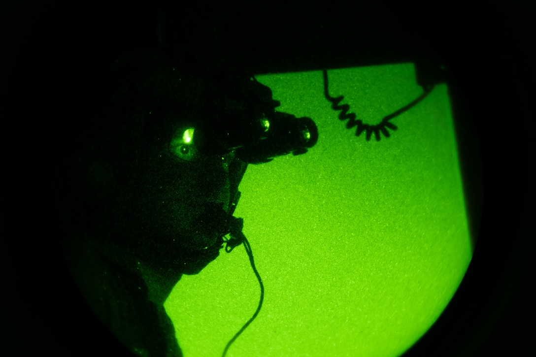 Capt. Sarah Aravich, 3rd Airlift Squadron pilot, views a map during a low-light training sortie on a C-17 Globemaster III, over Pennsylvania, Jan. 28, 2021. In combat, flying at night without artificial light minimizes visibility of the aircraft and reduces threat from potential enemies. The 3rd AS routinely trains to support global engagement through direct delivery of time-critical theater deployment assets and ensure aircrew operational readiness. (U.S. Air Force photo by Airman 1st Class Faith Schaefer)