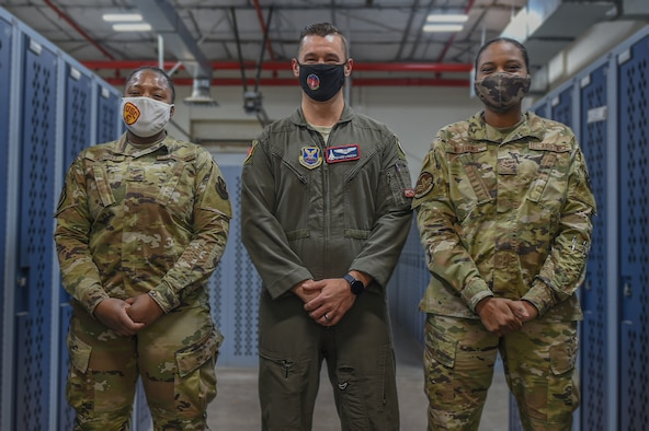 Airman First Class Keyannah Satchell, left, Captain Manuel Lamson, middle, Airman First Class Johnequa Williams, right, pose for a photo at the 7th Operations Group, Dyess Air Force Base, Texas, January 3, 2021. The Airmen created a Facebook page to help enlisted members learn more information about becoming an officer. (U.S. Air Force photo by Airman 1st Class Josiah Brown)