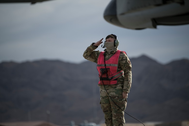 U.S. Air Force Tech. Sgt. Kacey Johnson, aircraft ordinance systems technician, assigned to the 122nd Fighter Wing, Fort Wayne, Indiana, salutes an A-10C Thunderbolt II pilot before flight at Red Flag 21-1, Nellis Air Force Base, Nevada, Jan. 23, 2021. The event, held several times per year, is a U.S. Air Force premier air-to-air combat training exercise. (U.S. Air National Guard photo by Staff Sgt. Justin Andras)