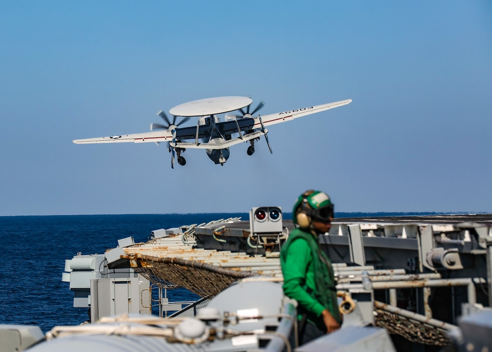 """An E-2D Hawkeye from the """"Bluetails"""" of Carrier Airborne Early Warning Squadron (VAW) 121 launches from the flight deck of the aircraft carrier USS Abraham Lincoln (CVN 72)."""