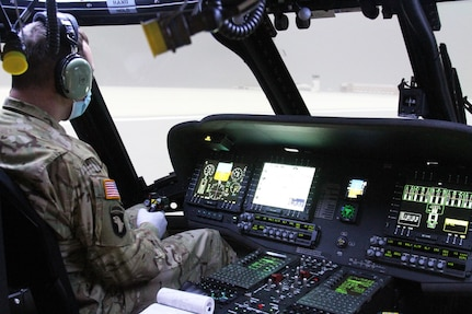 Chief Warrant Officer 2 Paul Schroader, an aviator with C Co, 5-159th GSAB based at Fort Knox, Kentucky, goes through instrument flight rules (IFR) flying in the new state-of-the-art Black Hawk Aircrew Trainer (BAT). The simulator is configured to give helicopter pilots refresher training on the UH-60M and UH-60L.