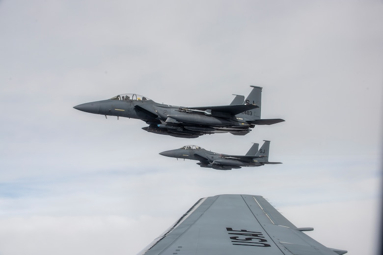 F-15E Strike Eagles from the 334th Fighter Squadron at Seymour Johnson Air Force Base, are guided by a KC-46A Pegasus, as they wait to be refueled on Jan. 21, 2021.