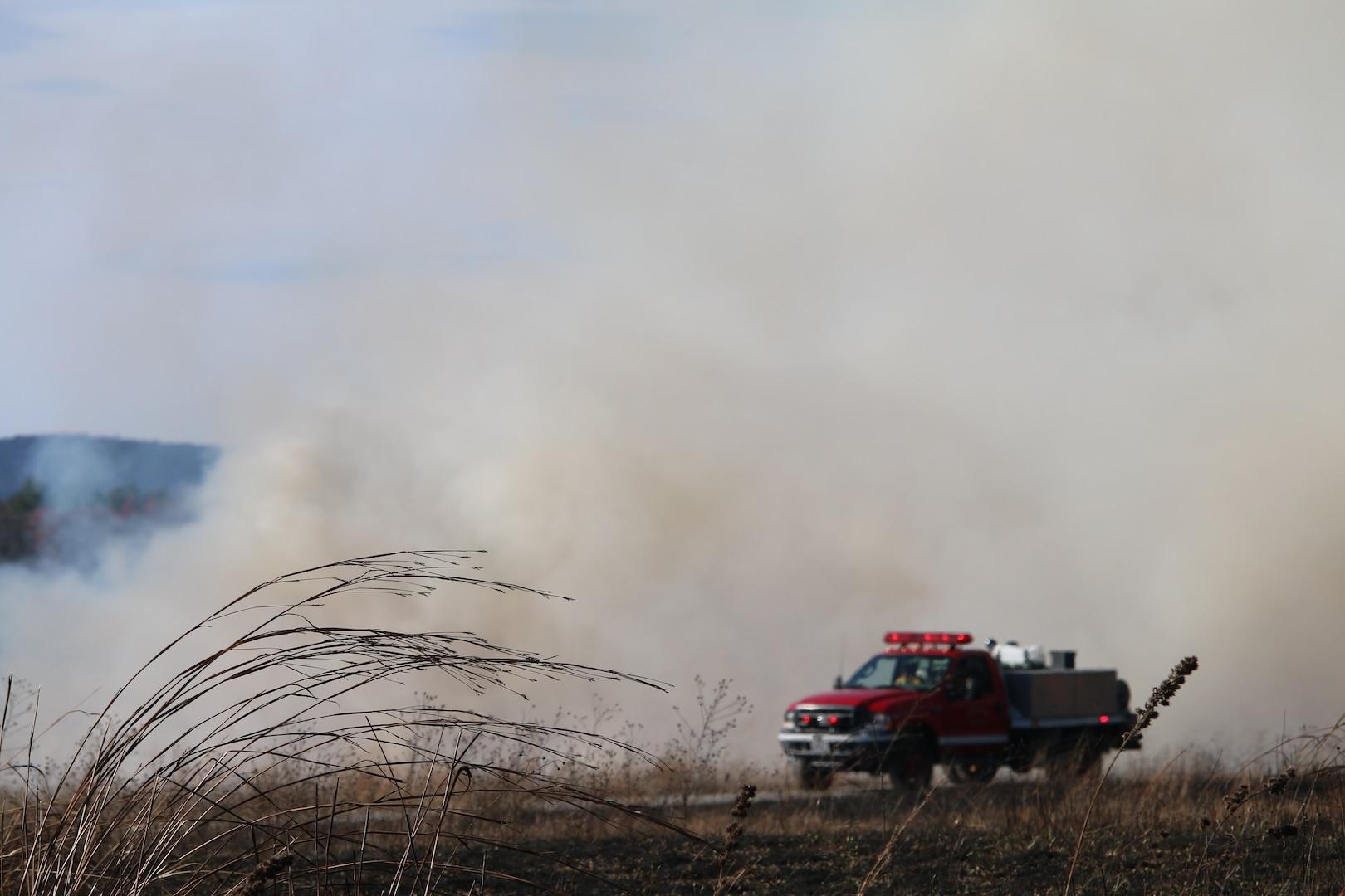 A safety crew participates in a prescribed burn.