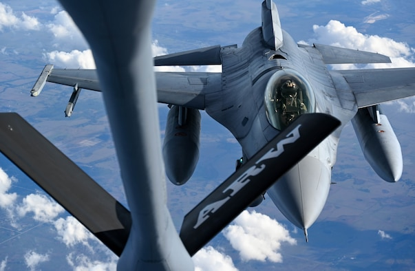 F-16s from the 93rd Fighter Squadron at Homestead Air Reserve Base, Florida, practice aerial refueling with a KC-135 Stratotanker from the 465th Air Refueling Squadron at Tinker Air Force Base, Oklahoma, Jan 27, 2021. This business effort training mission ensured that aircrew on multiple platforms received the necessary upgrade and competency training required to remain fully mission capable. (U.S. Air Force photo by Senior Airman Mary Begy)