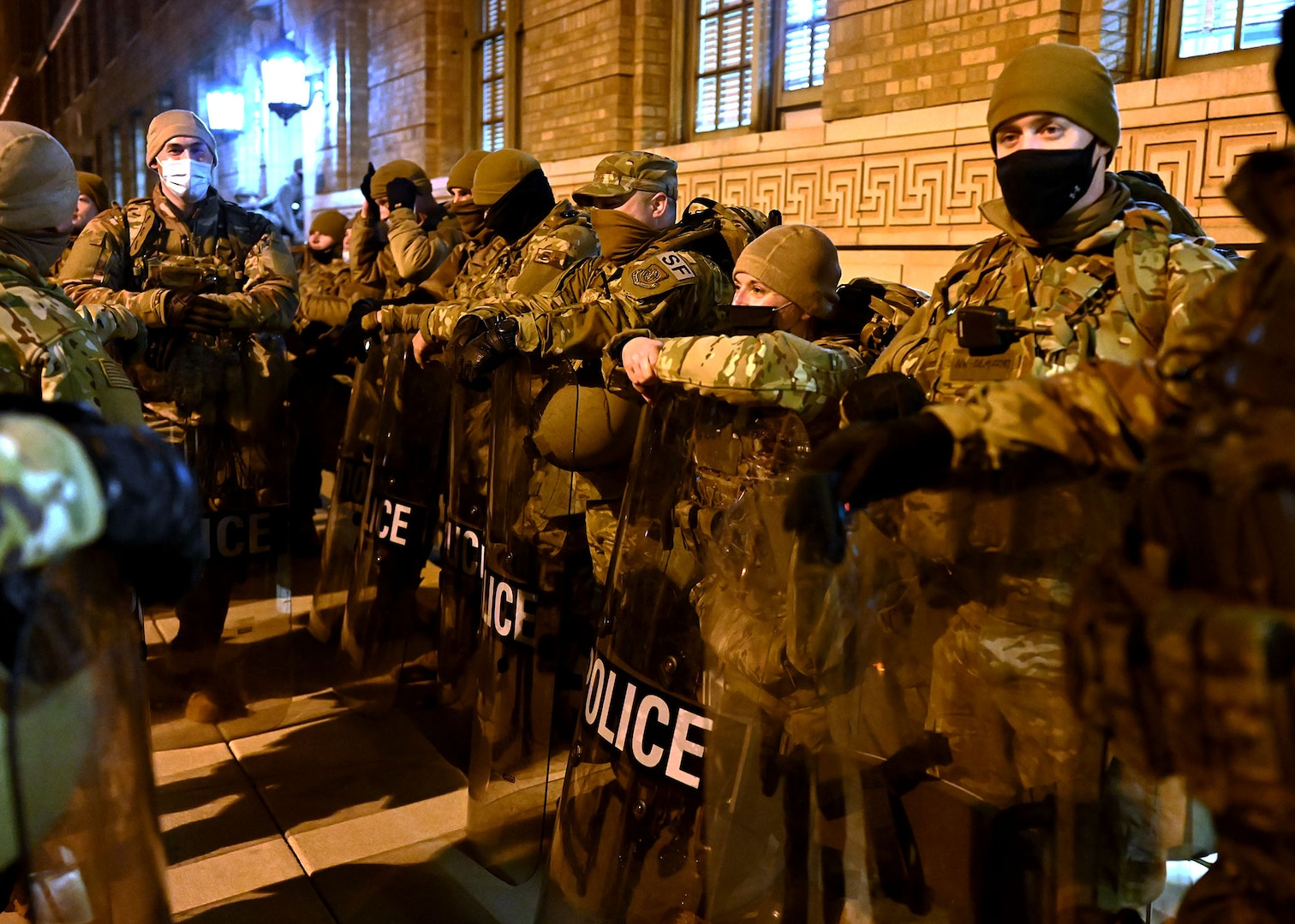 Airmen of the 157th Security Forces Squadron stage in the streets of the National Capital Region Jan. 20, 2021