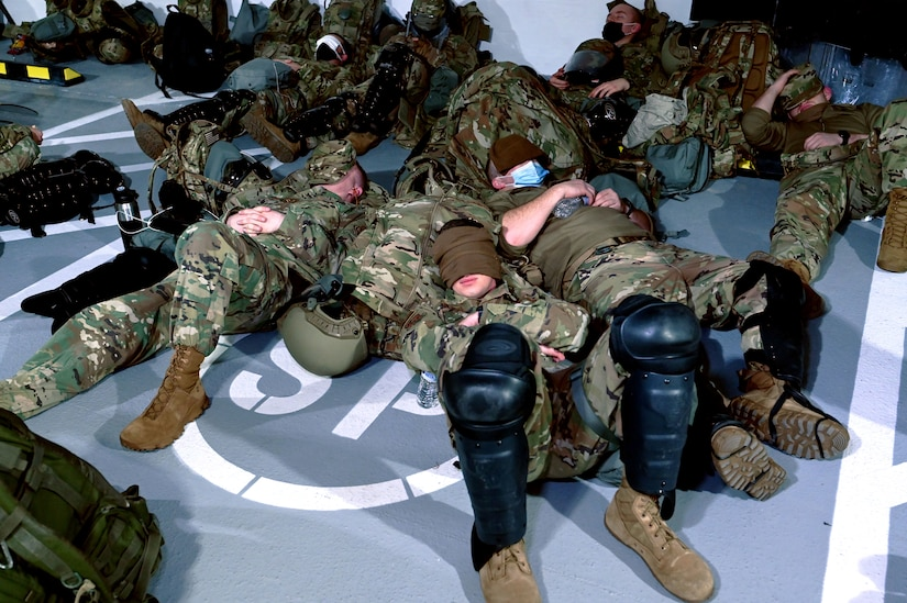 New Hampshire guardsmen slumber in a parking garage Jan. 19, 2021, in Washington, D.C. They staged there overnight to enable quick response to the Capitol area for the presidential inauguration.
