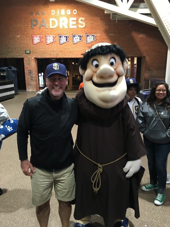 Man standing next to person in a costume.