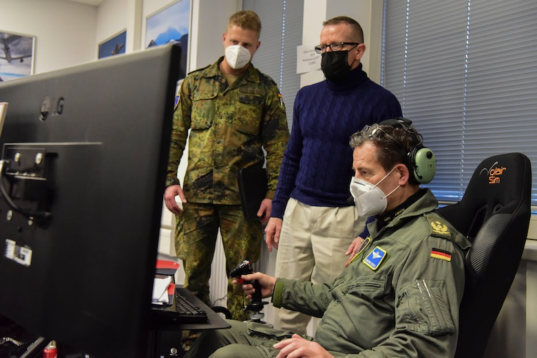 German Maj. Gen. Karsten Stoye, chief of staff at NATO's Headquarters Allied Air Command, tests the flight simulator during the Spartan Warrior 21-1 exercise at Einsiedlerhof Air Station, Germany, Jan. 25-28, 2021. This semi-annual training is conducted in the European environment and can encompass all phases of major combat operations.