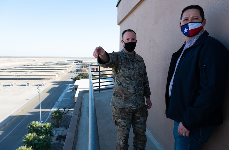 Col. Craig D. Prather, 47th Flying Training Wing commander, and Tony Gonzales, representative for Texas' 23rd Congressional District, overlook the fleet of trainer aircraft at Laughlin Air Force Base, Texas, on Jan. 14, 2021. Gonzales paid made his first visit to Laughlin since taking office earlier in January. (U.S. Air Force photo by Senior Airman Marco A. Gomez)