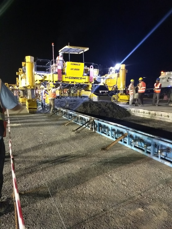 Contractors pave a runway during repairs at Ali Al Salem Air Base Kuwait. The project proved particularly challenging for the cost engineers from the U.S. Army Corps of Engineers Middle East District as extreme temperatures impacted the quality of the concrete.