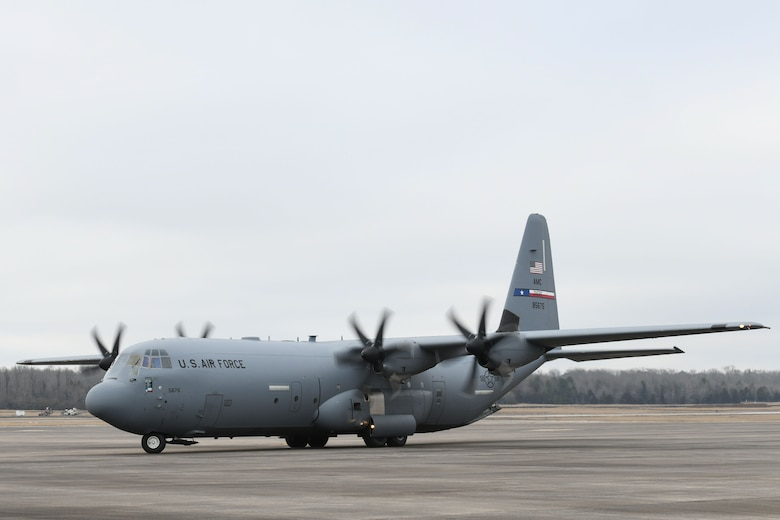 A C-130 taxis on the flightline