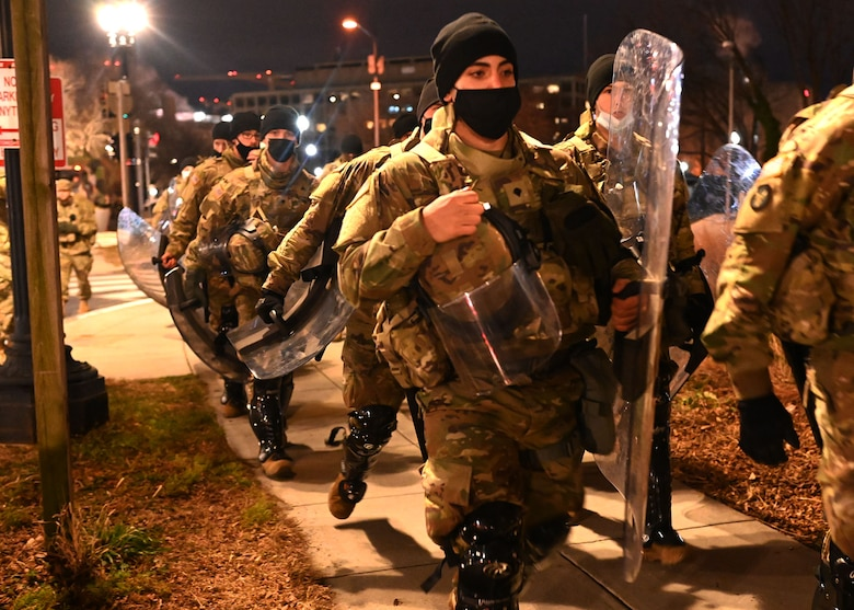 Spc. Joseph Lirette of the 160th Engineer Company, NHARNG, and fellow guardsmen march through the streets of Washington, D.C., on Jan. 20, 2021.