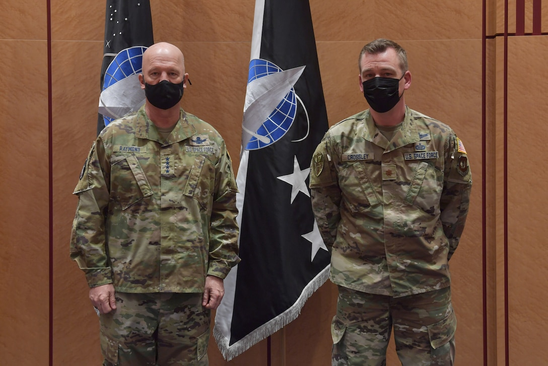 Guardians standing in front of U.S. Space Force flags.