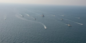 210124-N-XG173-1526 ARABIAN GULF (Jan. 24, 2021) Royal Saudi Naval Force ships and U.S. Navy sail in formation during exercise Nautical Defender (ND) 21 in the Arabian Gulf, Jan. 24. ND 21 is the capstone in a series of multi-national maritime security exercises designed to broaden levels of cooperation, support long-term regional security, and enhance military-to-military interoperability between the Kingdom of Saudi Arabia, UK and the U.S. (U.S. Navy photo by Mass Communication Specialist 2nd Class Aja Bleu Jackson)