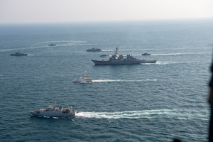 210124-N-XG173-1553 ARABIAN GULF (Jan. 24, 2020) Royal Saudi Naval Force ships and U.S. Navy sail in formation during exercise Nautical Defender (ND) 21 in the Arabian Gulf, Jan. 24. ND 21 is the capstone in a series of multi-national maritime security exercises designed to broaden levels of cooperation, support long-term regional security, and enhance military-to-military interoperability between the Kingdom of Saudi Arabia, UK and the U.S. (U.S. Navy photo by Mass Communication Specialist 2nd Class Aja Bleu Jackson)