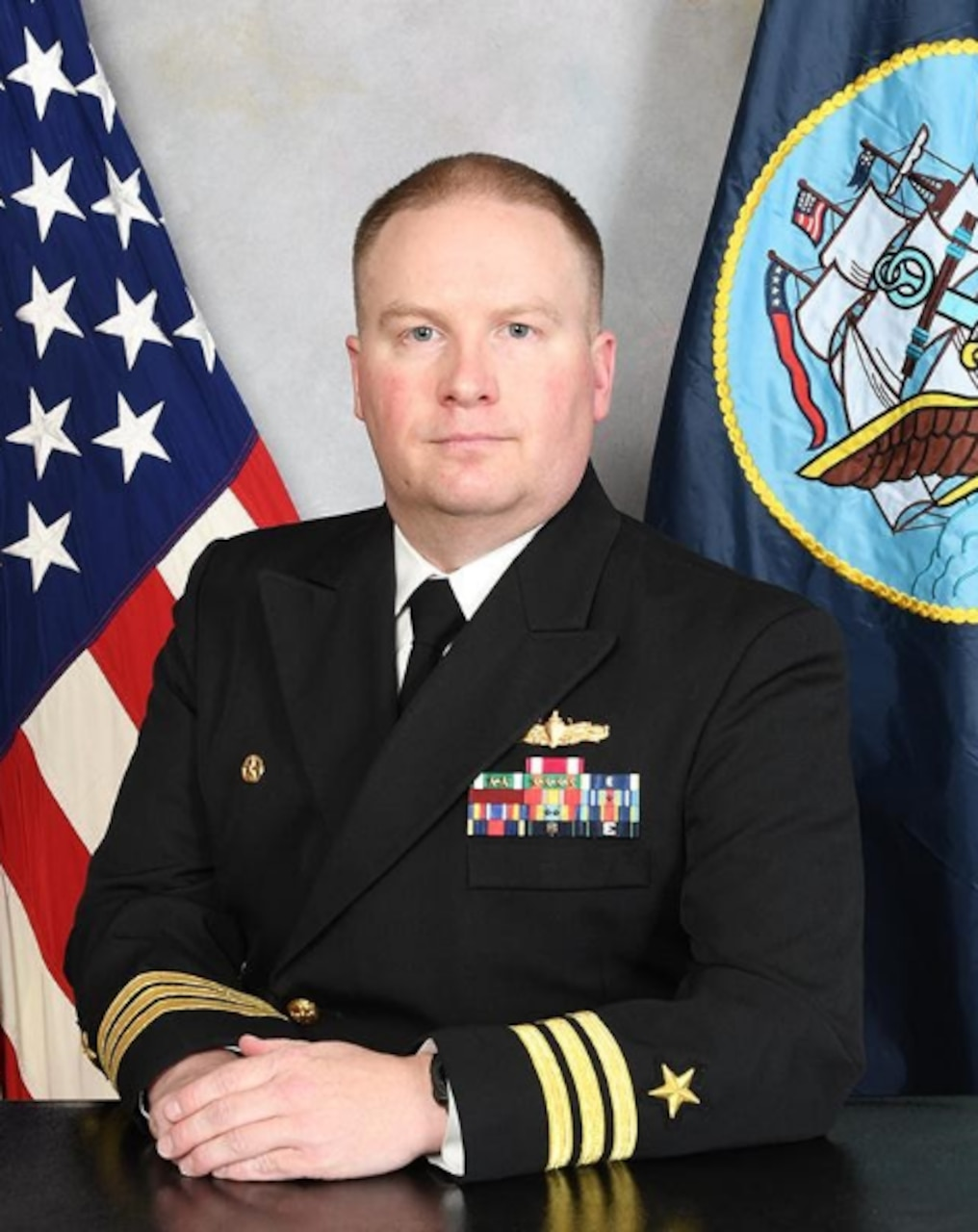 Studio portrait of Cmdr. Greg Page