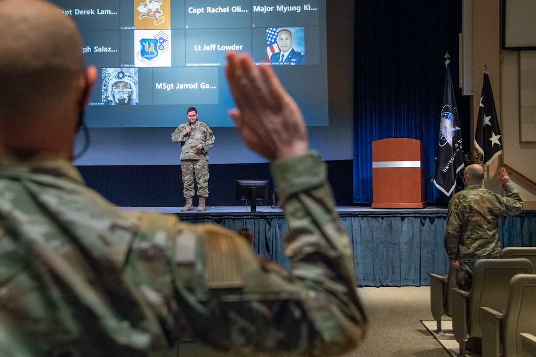 Lt. Gen. B. Chance Saltzman, U.S. Space Force deputy chief of Space Operations for Operations, Cyber and Nuclear, leads Airmen in a ceremonial oath of office and enlistment into the Space Force during a transfer ceremony on Maxwell Air Force Base, Alabama, Feb. 2, 2021. The 110 new Guardians, who attended the ceremony in person and virtually, represented units and mission partners across the Maxwell-Gunter installation, to include Air University and the Air Force Institute of Technology at Wright Patterson Air Force Base, Ohio.