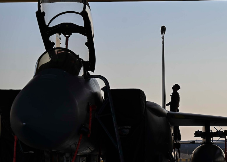 U.S. Air Force Senior Airman Austin Chamberlin, 380th Expeditionary Aircraft Maintenance Squadron F-15E Strike Eagle dedicated crew chief, performs inspections on an F-15E deployed to Al Dhafra Air Base, United Arab Emirates, Jan. 19, 2021.