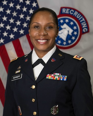 Command photo of LTC Fabienne Dennery in her Army Service Uniform in front of the American Flag and the BN Colors