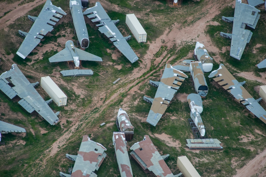 An aerial photo shows chopped-up bombers in the desert.