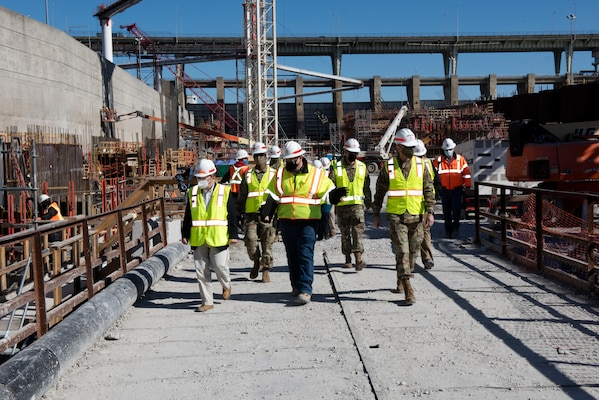 Tommy Long (Center), U.S. Army Corps of Engineers Nashville District's resident engineer for the Chickamauga Lock Replacement Project, leads Lt. Gen. Scott Spellmon (Right), 55th chief of Engineers, and Congressman Chuck Fleischmann, Tennessee District 3, through the construction site where crews are constructing the lock chamber Feb. 3, 2021. (USACE photo by Lee Roberts)