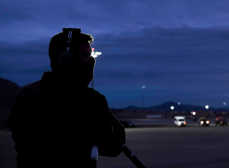 U.S. Air National Guard Staff Sgt. James Whitney, 131st Maintenance Squadron crew chief, waits to start a B-2 Spirit Stealth Bomber post-flight check during Red Flag 21-1, at Nellis Air Force Base, Nevada, Feb. 1, 2021. In order to ensure Team Whiteman always upholds its global deterrence responsibility, Red Flag challenged Airmen to operate in a limited environment to better enhance their readiness and ensure mission success. Aircrews rotated their mission duties throughout the large-force exercise, expanding their ability to plan and execute operations best fit for various contingency scenarios. (U.S. Air Force photo by Staff Sgt. Sadie Colbert)