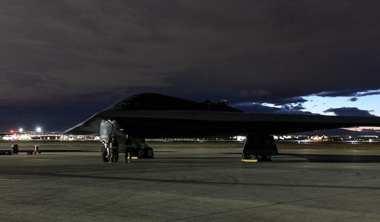A B-2 Spirit Stealth Bomber sits on a flightline during Red Flag 21-1, at Nellis Air Force Base, Nevada, Feb. 1, 2021. During Red Flag 21-1, the 393rd Expeditionary Bomb Squadron flew B-2 Spirit Stealth Bomber training missions with multiple aircraft in order to further enhance their experience for future sorties. Aircrews rotated their mission duties throughout the large-force exercise, expanding their ability to plan and execute operations best fit for various contingency scenarios. (U.S. Air Force photo by Staff Sgt. Sadie Colbert)