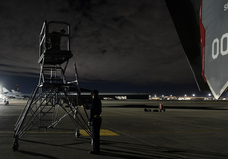 U.S. Air Force Senior Airman Matthew Anderson, left, and Staff Sgt. Sean Cadigan, both 509th Maintenance Squadron signature diagnostics technicians, setup an aircraft standing during Red Flag 21-1, at Nellis Air Force Base, Nevada, Feb. 1, 2021. Along with aircrew, approximately 100 Team Whiteman Airmen participated in the large-force exercise as the lead wing. As the lead Wing, RF 21-1 enabled Team Whiteman to maintain a high state of readiness and proficiency, while validating their always-ready global strike capability. (U.S. Air Force photo by Staff Sgt. Sadie Colbert)
