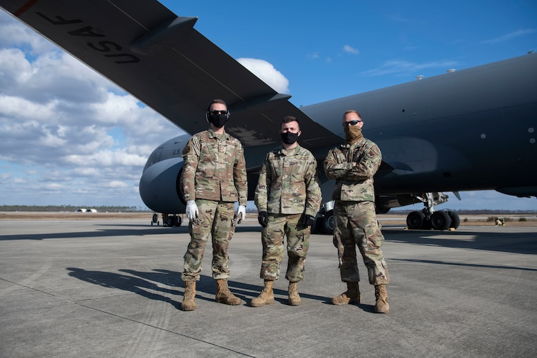 From left, U.S. Air Force Senior Airman Evan Keough, 325th Logistics Readiness Squadron air transportation function journeyman, U.S. Air National Guardsman Senior Airman Hunter Smith, 601st Air Operations Center airlift requirement planner, and U.S. Air Force Staff Sgt. Brady Runk, 325th LRS air operations function supervisor pose for a photo in front of a KC-46 Pegasus on Tyndall Air Force Base, Florida, Jan. 30, 2021. The air transportation flight ensures all cargo is air worthy and safe for flight operations. (U.S. Air Force photo by Airman 1st Class Tiffany Price)