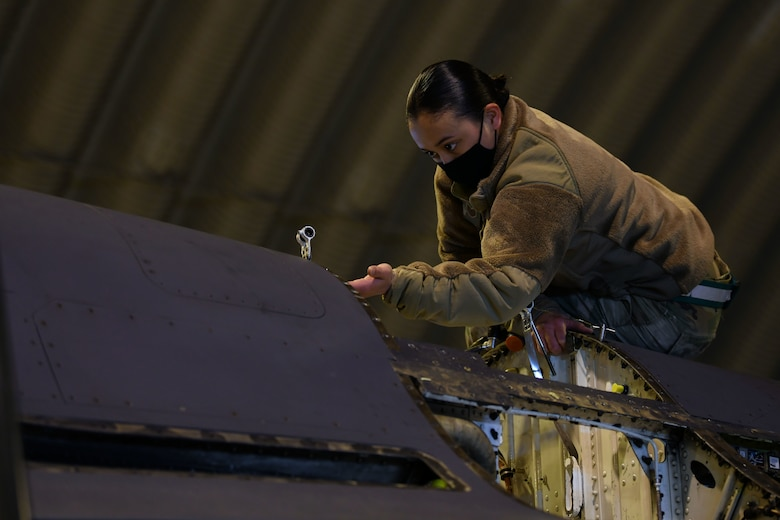 U.S. Air Force Tech. Sgt. Nicole Almario, 31st Aircraft Maintenance Squadron weapons load crew chief, examines the inside of an F-16 Fighting Falcon at Aviano Air Base, Italy, Feb. 1, 2021. Crew chiefs routinely inspect and service the aircraft to ensure mission and operational readiness. (U.S. Air Force photo by Senior Airman Ericka A. Woolever)