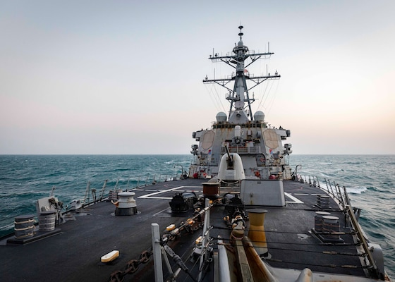 The Arleigh Burke-class guided-missile destroyer USS John S. McCain (DDG 56) transits through South China Sea
