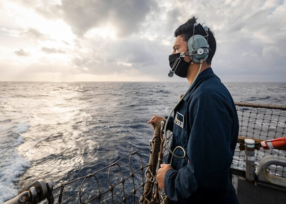 Seaman Recruit Richard Lopez, from Tulare, Calif., stands watch as aft lookout on the flight deck aboard the Arleigh Burke-class guided-missile destroyer USS John S. McCain (DDG 56).