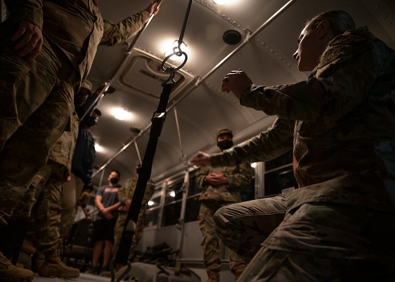 Participants in the 380th Air Expeditionary Wing (AEW) Honorary Members Program learn how to properly secure stretchers inside an ambulance bus during a 380th Expeditionary Medical Group (EMDG) immersion event at Al Dhafra Air Base, United Arab Emirates, Jan. 28, 2021.