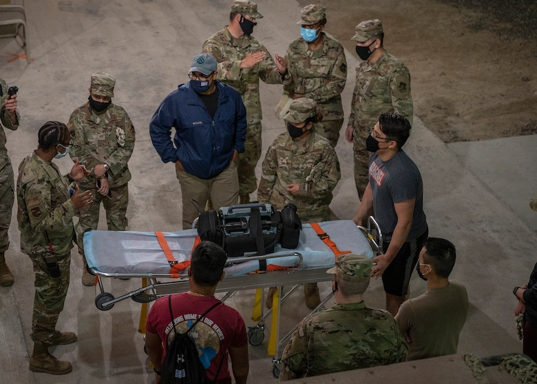 Participants in the 380th Air Expeditionary Wing Honorary Members Program learn proper stretcher procedures during a 380th Expeditionary Medical Group (EMDG) immersion event at Al Dhafra Air Base, United Arab Emirates, Jan. 28, 2021.