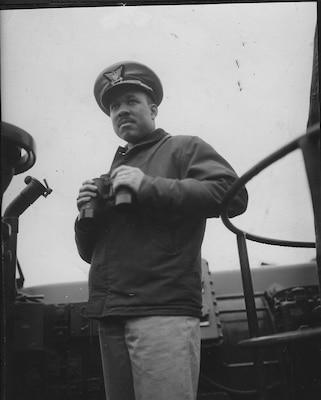 8.Lt.j.g. Joseph Jenkins on the bridge late in World War II. (photo courtesy of the Jenkins Family)