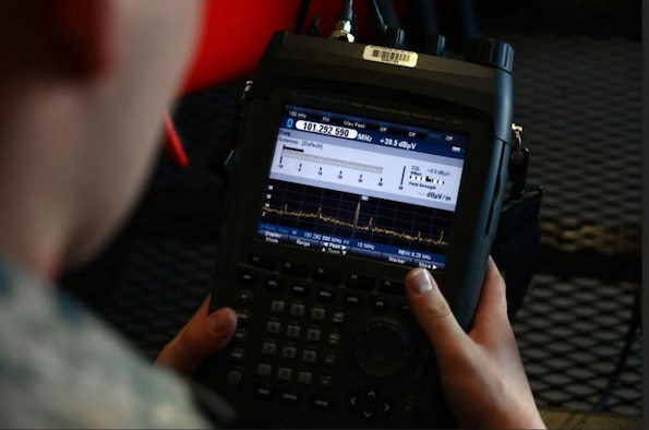 Staff Sgt. Geoffery Smith, 20th Communications Squadron installation spectrum manager, views the display on a radio spectrum analyzer at Shaw Air Force Base, S.C., in Janurary 2017. Spectrum managers across the Air Force plan, provide and preserve access to the electromagnetic spectrum for Department of Defense activities. (U.S. Air Force photo by Airman 1st Class Kathryn R.C. Reaves)