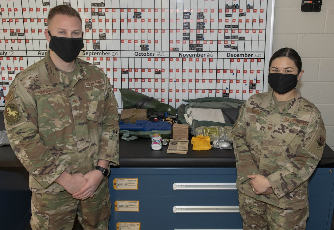Photo of Airmen with survival kit.