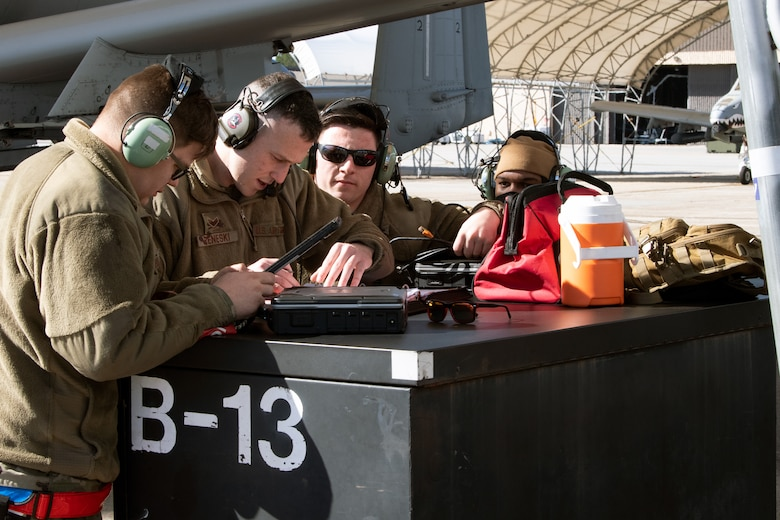 A photo of Airmen preparing an aircraft for takeoff
