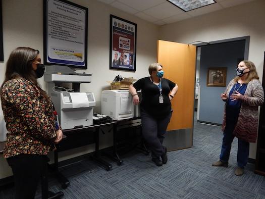 Women standing in room