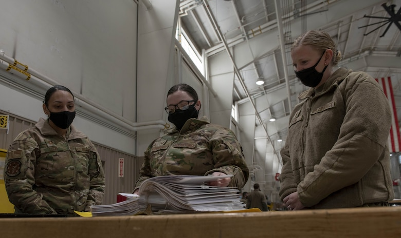 Photo of Airmen reading a manual.