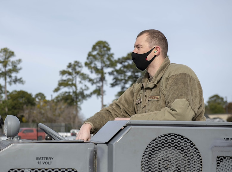 Photo of an Airman operating a vehicle.