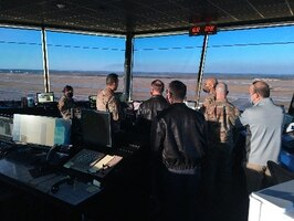 Flightline of the Future Summit attendees got a bird's eye view of the flightline from Tyndall's air traffic control tower yesterday. They discussed flight operations, its challenges and how best to improve operations with air traffic controllers. (U.S. Air Force photo by Donald Arias)