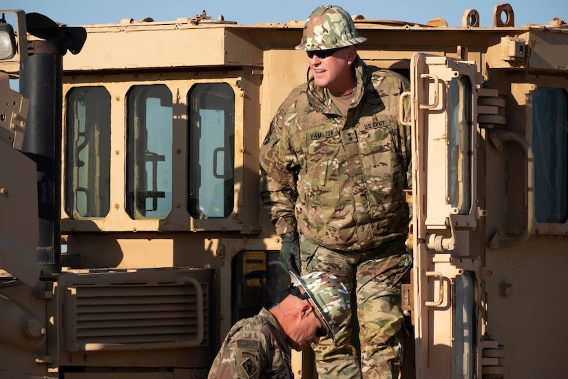 Commanding General of Task Force Spartan, Major General Patrick Hamilton and Chief of Staff, Colonel Michael Hunt Operate the Theater Engineer Brigade's Massive D9 Dozer.