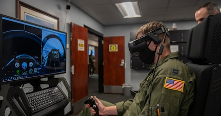 U. S. Air Force Capt. Kyle Maloney, a pilot temporarily assigned to the 559th Flying Training Squadron, test flies a T-6 Texan II simulator during an immersive training device evaluation at Joint Base San Antonio-Randolph, Feb. 1, 2021.