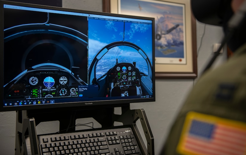 U. S. Air Force Capt. Kyle Maloney, a pilot temporarily assigned to the 559th Flying Training Squadron test flies a T-6 Texan II simulator during an immersive training device evaluation.