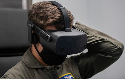 U. S. Air Force Lt. Jeremiah Knipe, T-6 instructor pilot assigned to the 85th Flying Training Squadron, dons an immersive training device headset during evaluations at Joint Base San Antonio-Randolph, Feb. 2, 2021.