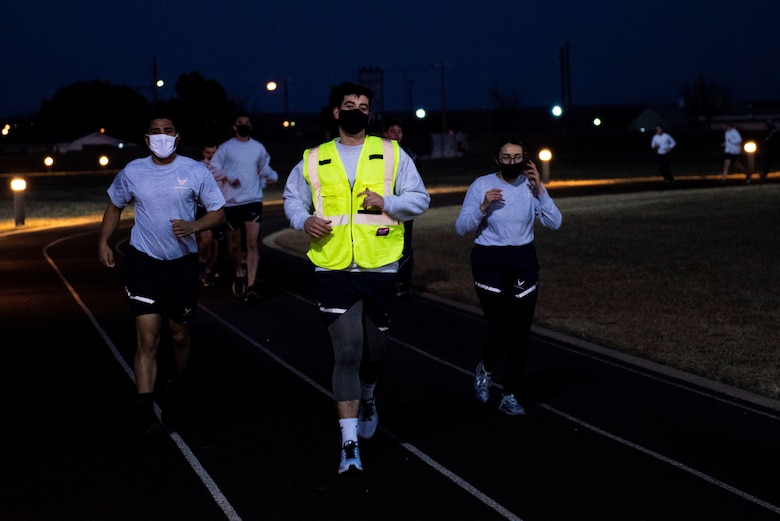 Student pilots starting off their morning PT with a mile and a half run on Feb. 01, 2021 at Laughlin Air Force Base, Texas. The students performed a three-mile run to adhere to Air Force standards. (U.S. Air Force photo by Airman 1st Class David Phaff)
