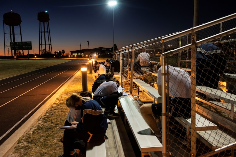 Student pilots filling out forms before starting their morning PT on Feb. 01, 2021 at Laughlin Air Force Base, Texas. During the course the students met at the track for their morning Pt. (U.S. Air Force photo by Airman 1st Class David Phaff)