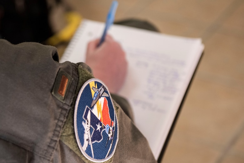 A Student pilot taking notes over the courses they will be expected to take during their course. Feb. 03, 2021 at Laughlin Air Force Base, Texas. Students must have a good study habit and time management skills to be able to keep up with the workload. (U.S. Air Force photo by Airman 1st Class David Phaff)