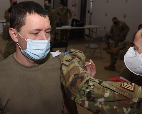 Sgt. Kevin LaPierre receives his second dose of COVID-19 vaccine from Lt. Col. Sarah Davis Feb. 3, 2021, at Camp Johnson, Vermont. Recipients of the second dose commonly experience mild flu-like symptoms including soreness and mild fever. LaPierre is a fueler with the Vermont National Guard's 186th Brigade Support Battalion. Davis is a registered nurse and the officer in charge of immunizations for the Vermont Air National Guard's 158th Medical Group.